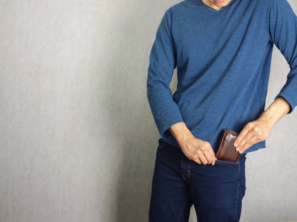 Put wallet in the pant stock photo