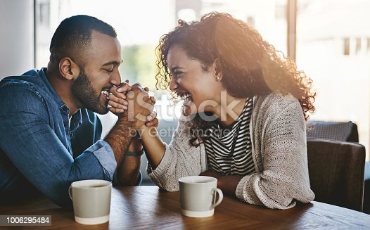 Shot of a young couple spending time together at a cafe