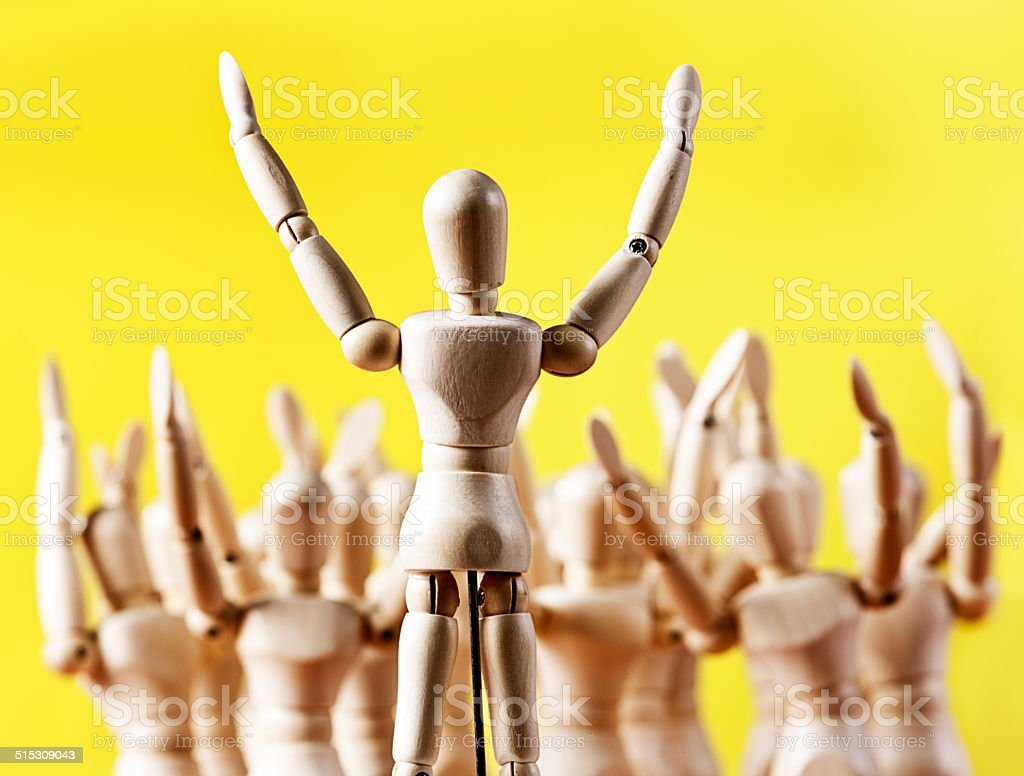 Put your hands up! Enthusiastic puppet leader. stock photo