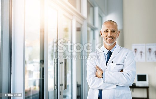 Portrait of a mature doctor standing in a hospital