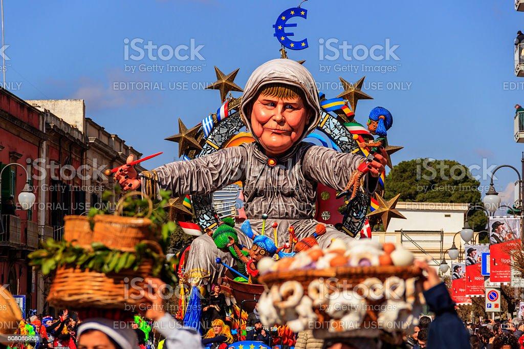Putignano Carnival: floats. European politician: Angela Merkel torture Europe.ITALY(Apulia) stock photo