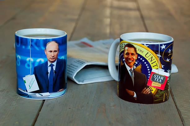 Putin and Obama Rotterdam, Netherlands - October 3, 2014: tea mugs with photo`s of Putin and Obama barack obama stock pictures, royalty-free photos & images