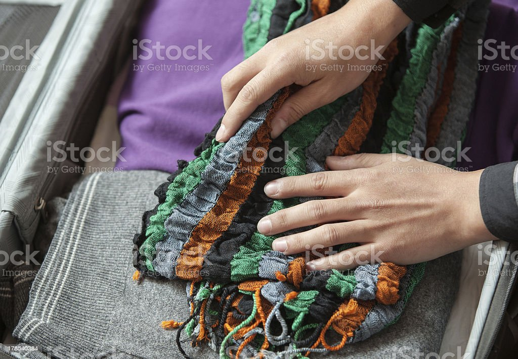 Puts things in a suitcase royalty-free stock photo
