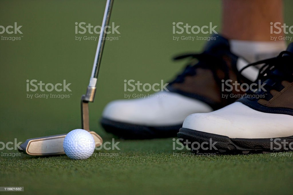 Putter, Golf Ball and Feet royalty-free stock photo