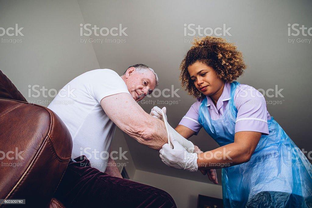 Putting a Bandage on stock photo