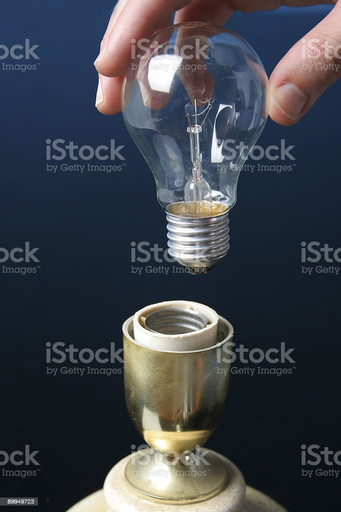 putting a ligth bulb royalty-free stock photo