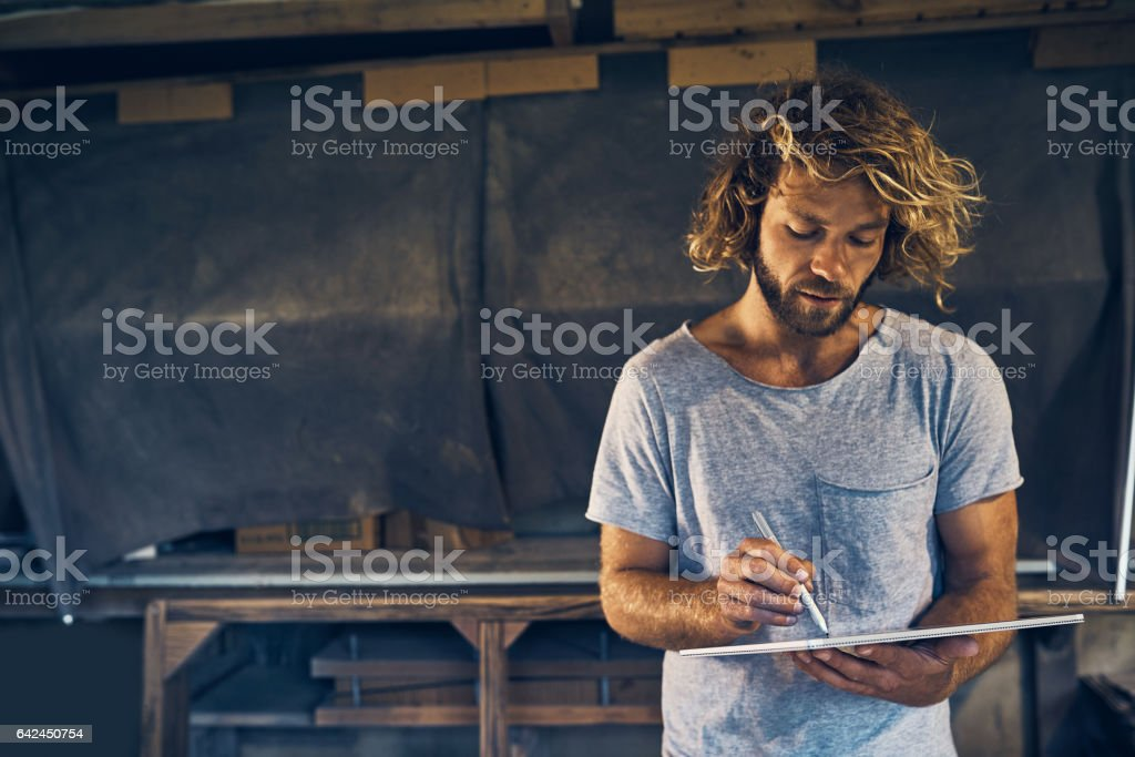 Putting a pen to his latest project stock photo