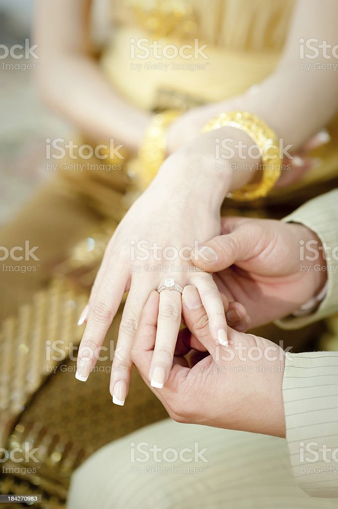 Putting a wedding ring royalty-free stock photo