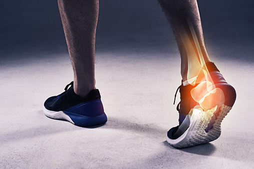 Cropped shot of a young man in the studio with cgi highlighting his ankle injury