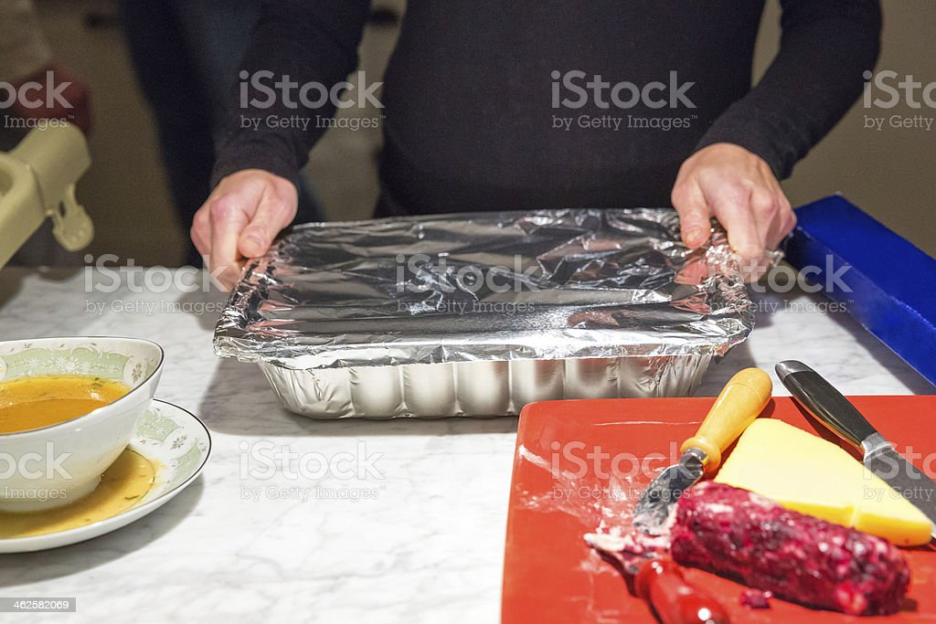Putting away Thanksgiving leftovers stock photo
