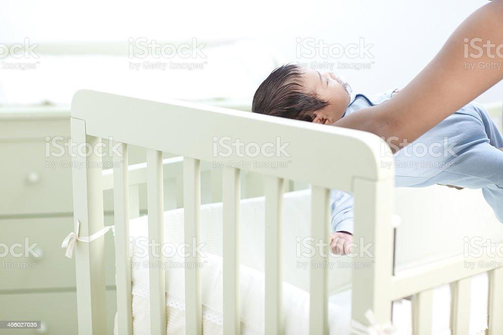 Putting baby down to sleep. stock photo
