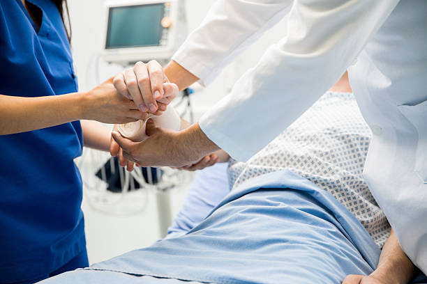 putting bandage on a patient - verbrand stockfoto's en -beelden