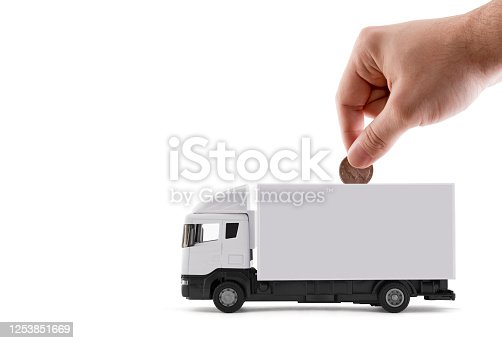 Putting coin into the white cargo delivery truck on white background