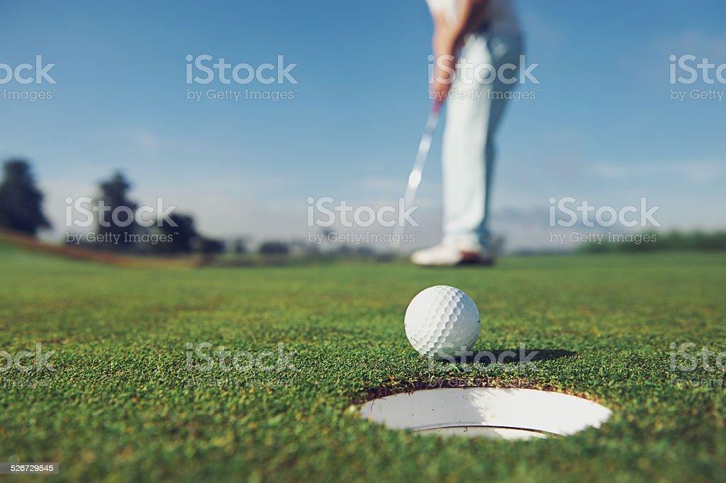 putting golf man stock photo