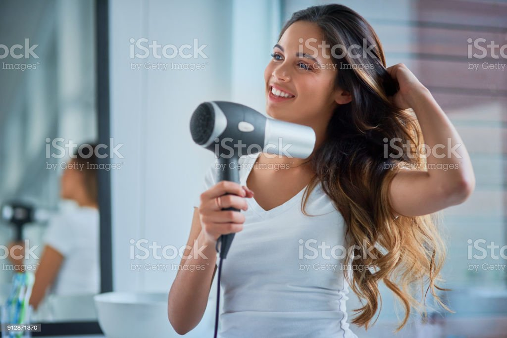 Putting great care into her hair stock photo