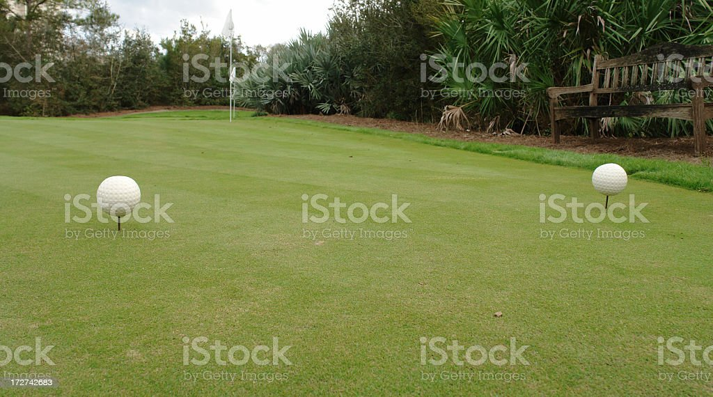 Putting Green & Bench royalty-free stock photo