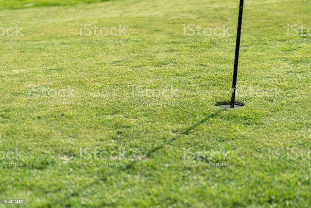 putting green on a sunny day stock photo