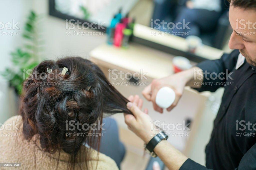 Woman having her hair styled at hair salon