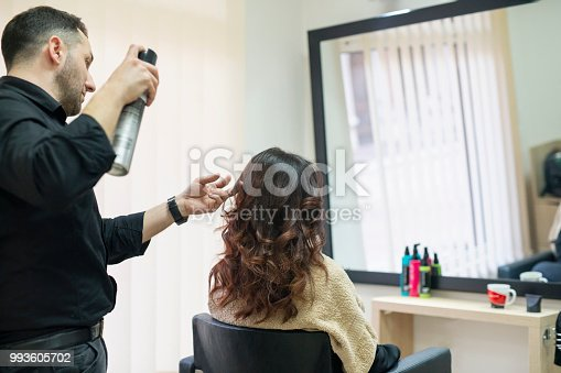 Spraying woman's hair