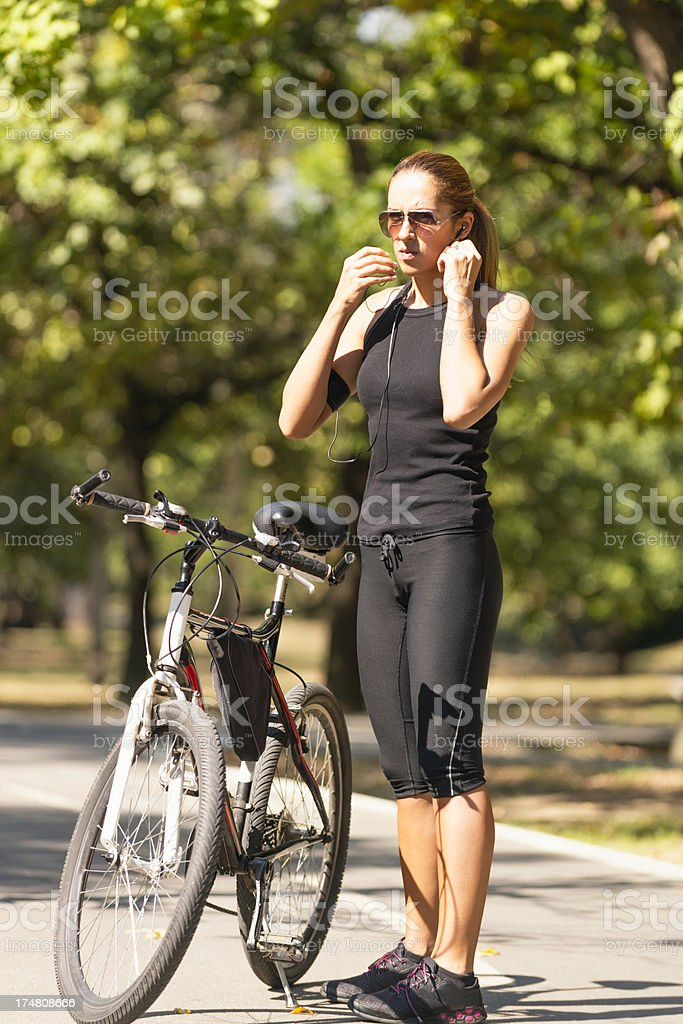 Putting headphones and getting ready to ride royalty-free stock photo