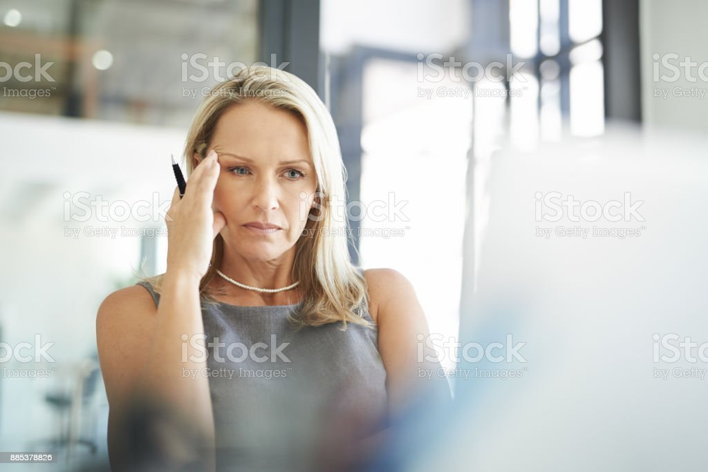 Putting her all into her project stock photo