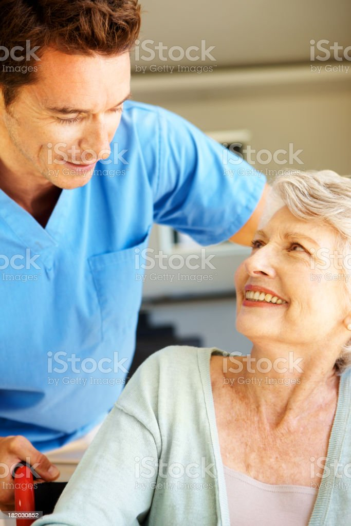 Putting her at ease - Senior Healthcare royalty-free stock photo