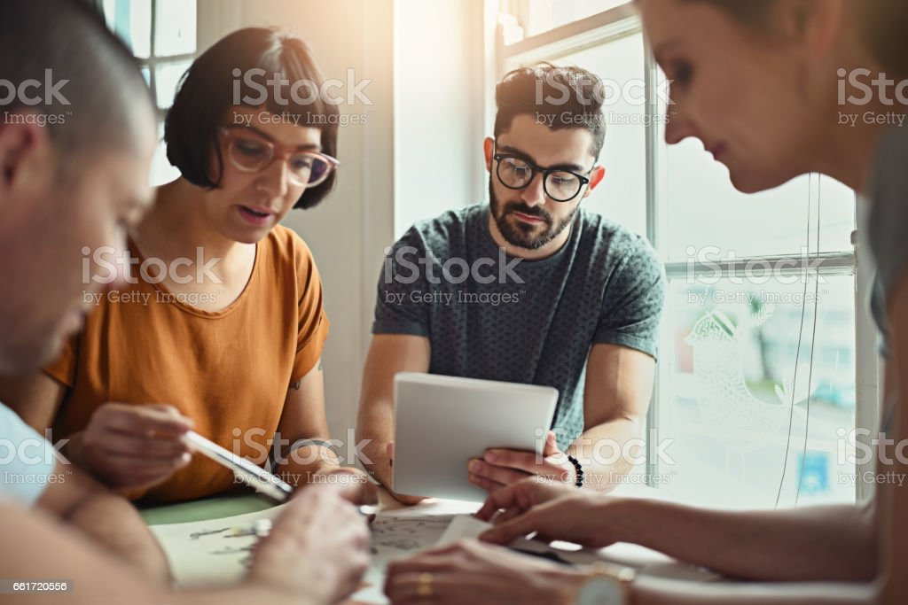 Putting his digital designs on paper stock photo
