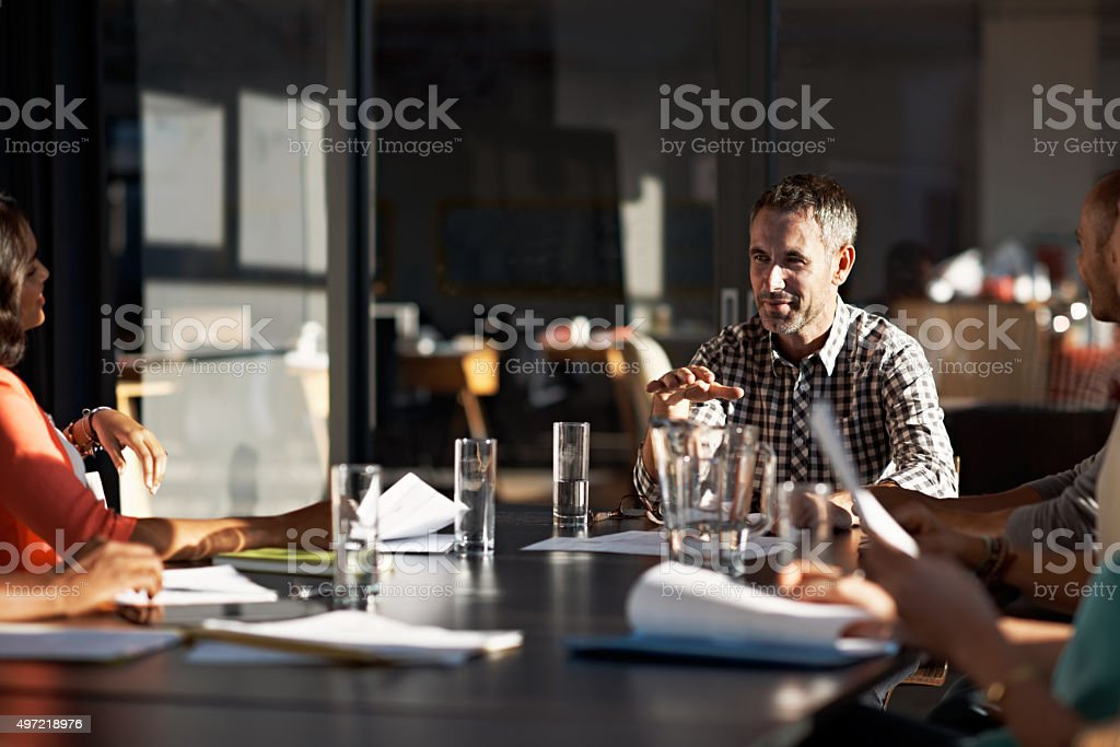 Putting ideas on the table stock photo