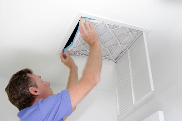 Putting In a New Air Filter stock photo