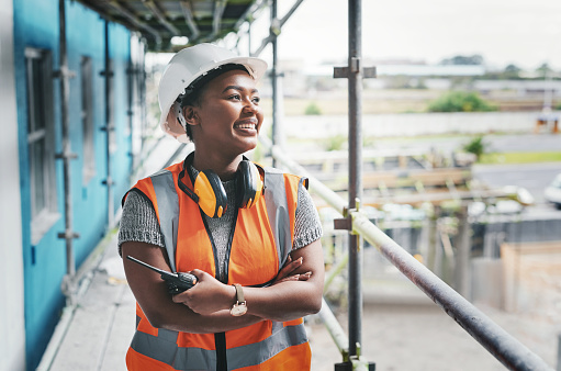 Shot of a young woman working at a construction site