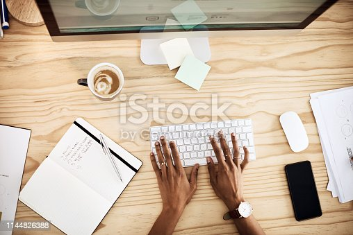 Shot of a young businesswoman working in a modern office