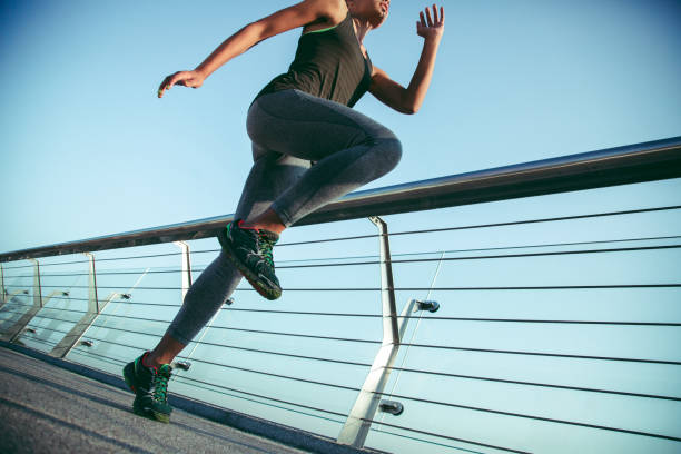 Putting knee up while exercising outdoors stock photo stock photo