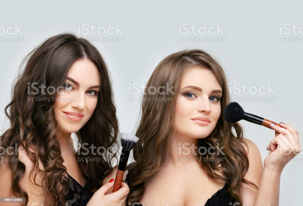 Woman with a brush for make-up