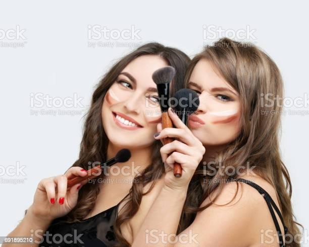 Putting makeup woman with a brush for makeupfemale friends putting picture id691895210?b=1&k=6&m=691895210&s=612x612&h= stw7 lewdcpafw3ifxzwki4v41jk8xncsiv9eajfvi=