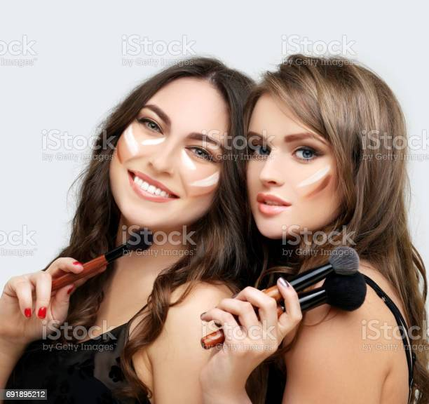 Putting makeup woman with a brush for makeupfemale friends putting picture id691895212?b=1&k=6&m=691895212&s=612x612&h=am1lnskafpt8g2zjs9heb3xolwxq6zl6yvsl9u5ubny=