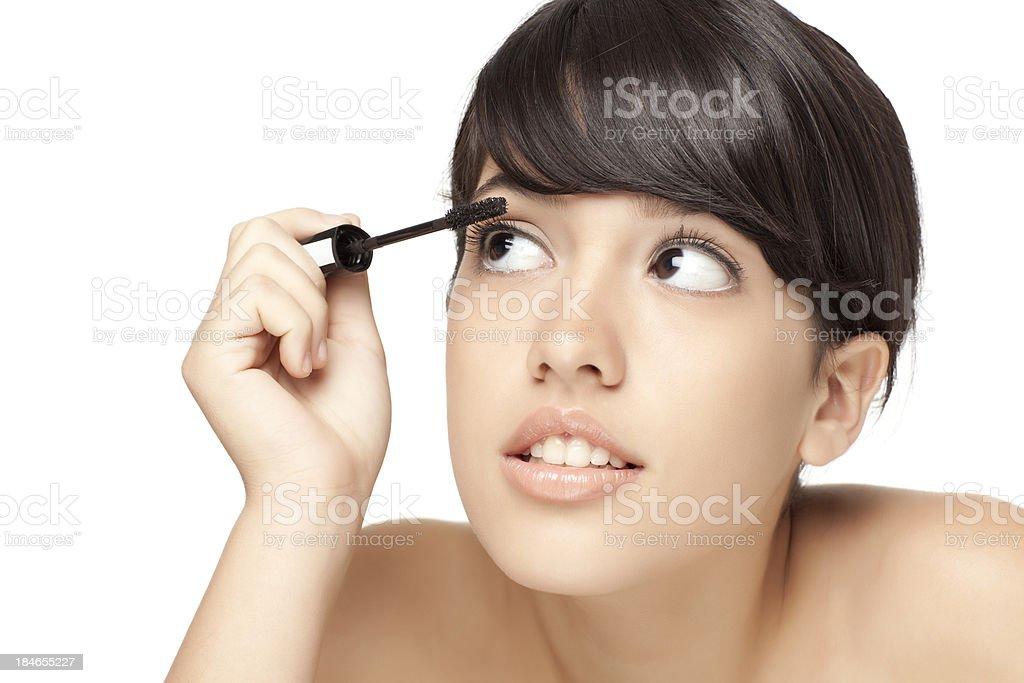 Putting mascara. royalty-free stock photo