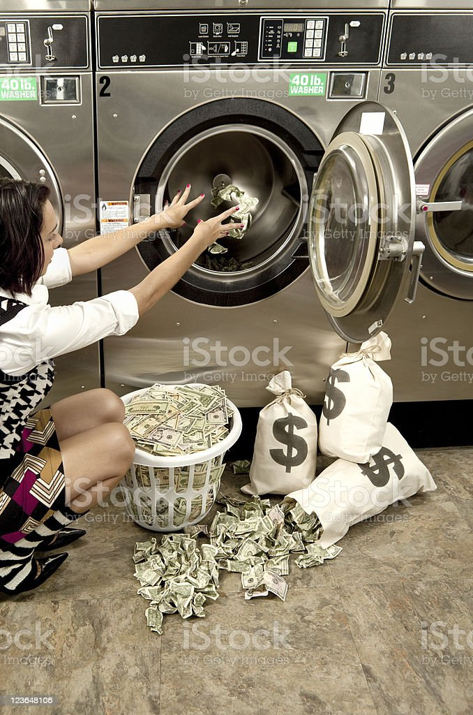 Putting Money in a Washer stock photo