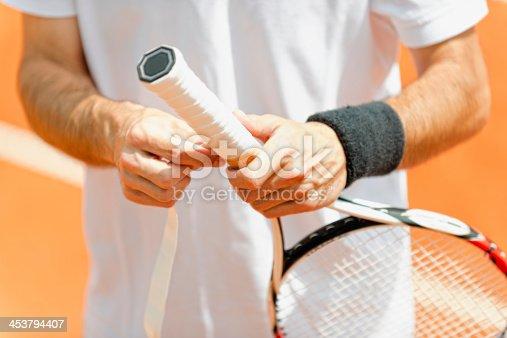istock Putting new grip tape on tennis racket 453794407