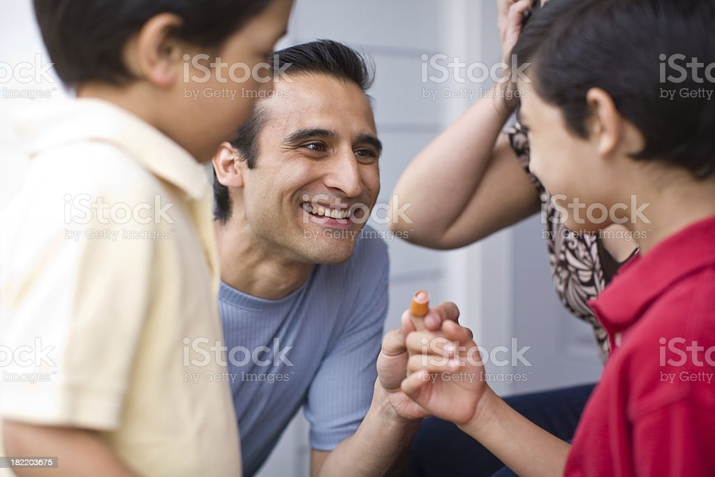 putting on a band-aid royalty-free stock photo