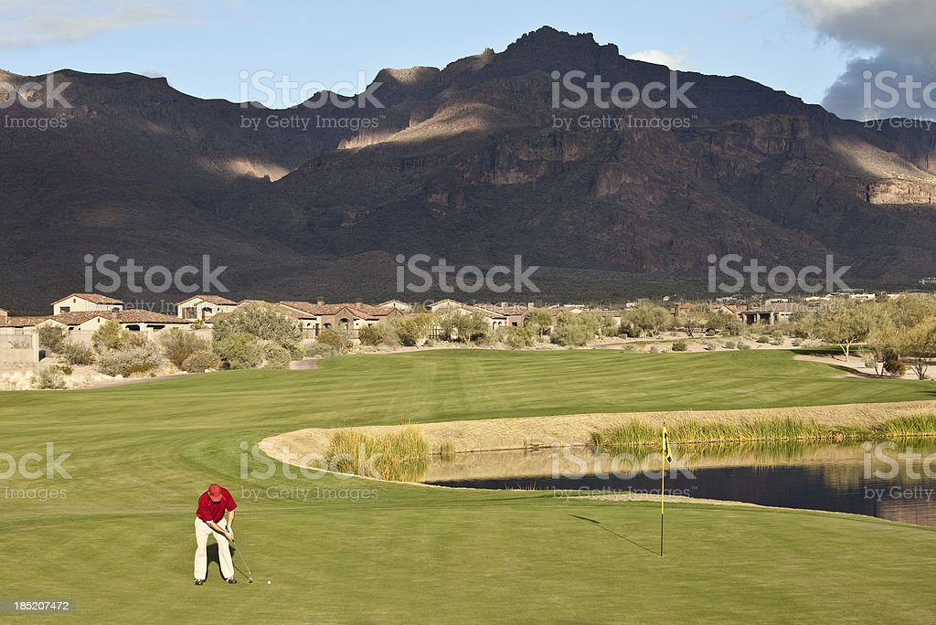 Putting on a Desert Golf Course royalty-free stock photo