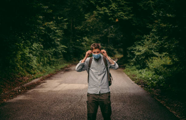 Putting on a protection mask in nature