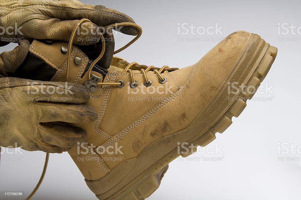 putting on a work boot stock photo