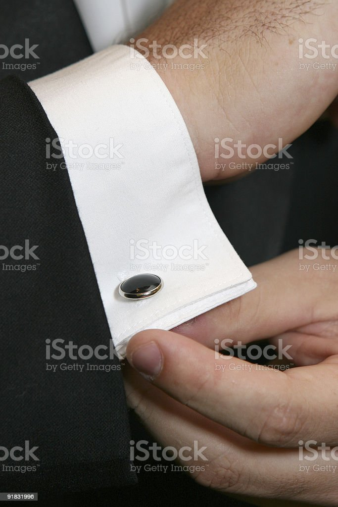 Putting On Cuff Links royalty-free stock photo