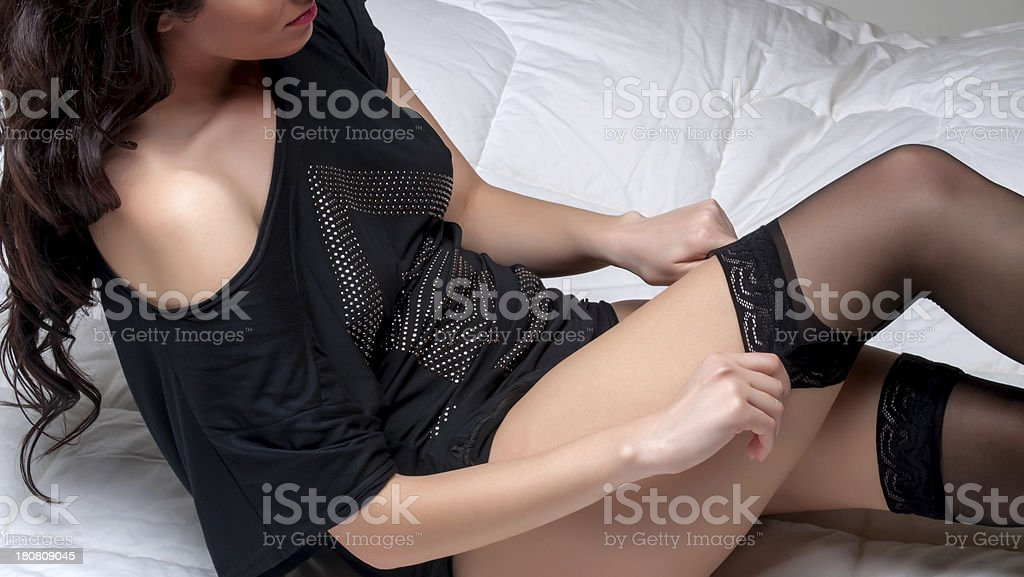 Putting on garter belt royalty-free stock photo