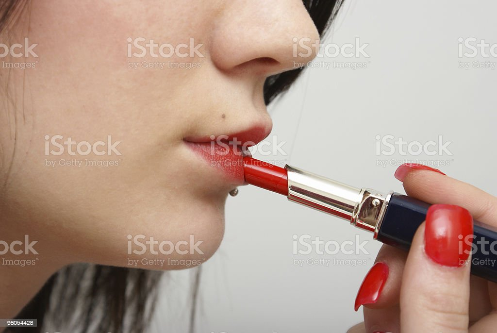Putting on Lipstick royalty-free stock photo