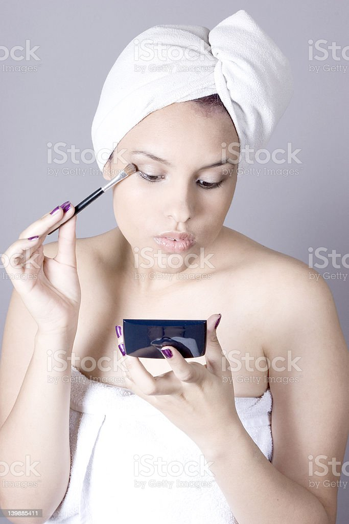 Putting on makeup royalty-free stock photo
