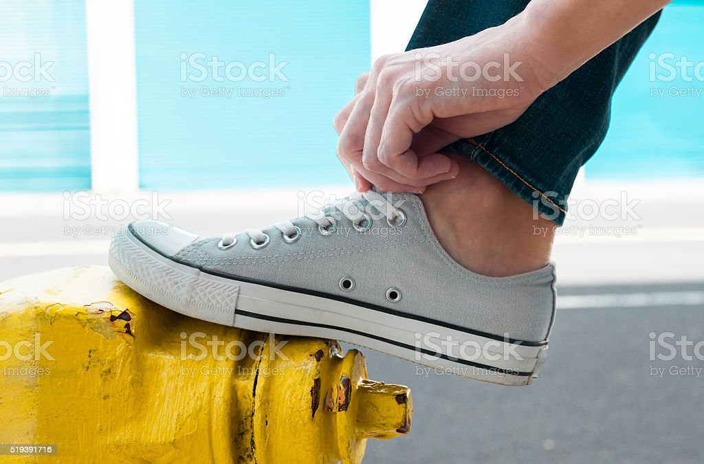 Putting on pair of shoes stock photo