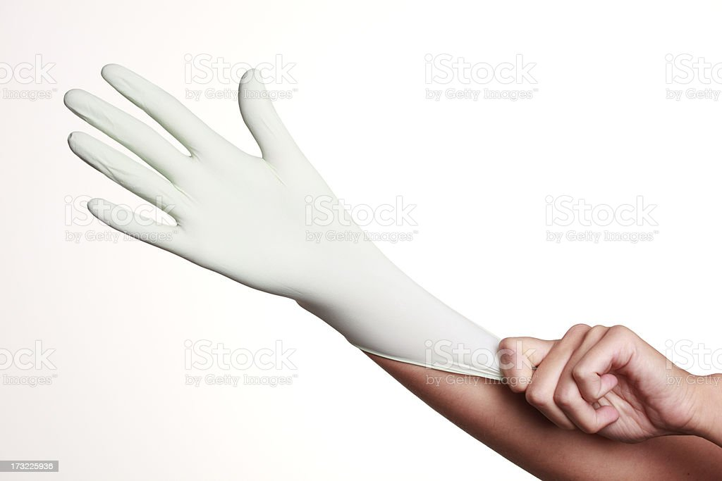 Putting on protective glove stock photo