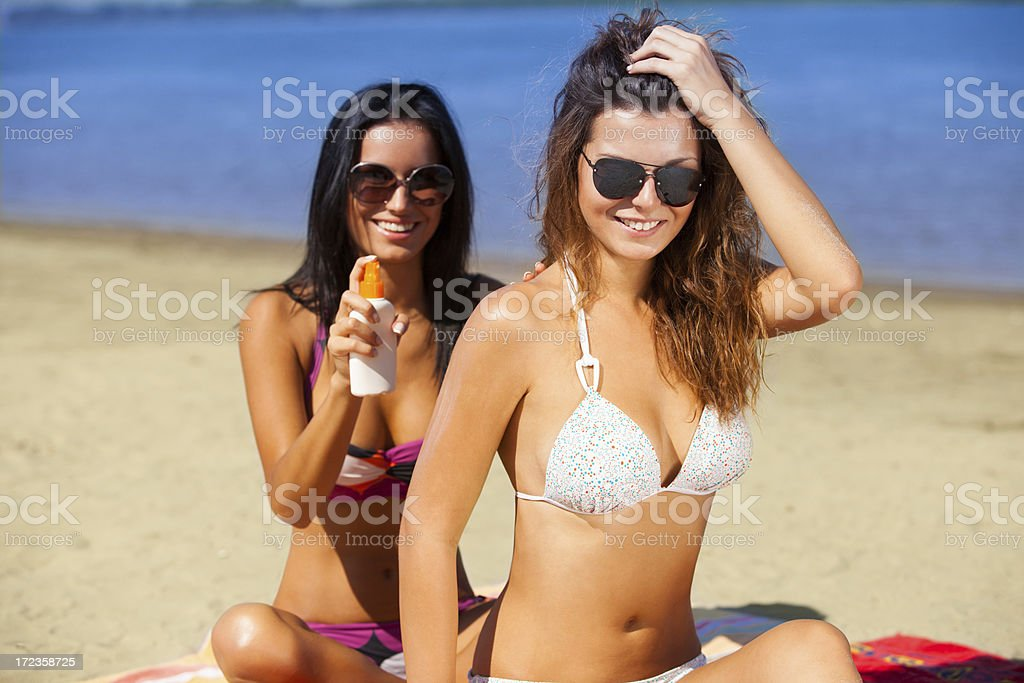 Putting on suntan lotion royalty-free stock photo