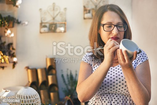 627000458istockphoto Putting on the finishing touches 627000368